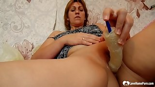 Redhead cougar uses a sex knick-knack on herself