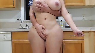 Scorching mother and sonny close by kitchenette