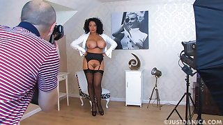Busty girl Danica Collins strips and teases up her big bosom