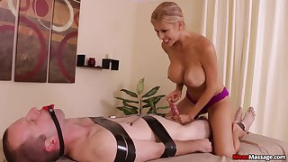 Stacked with the addition of slutty masseuse subjects client nigh bondage with the addition of teasing handjob